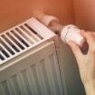 Hand,Adjusting,The,Knob,Of,Heating,Radiator